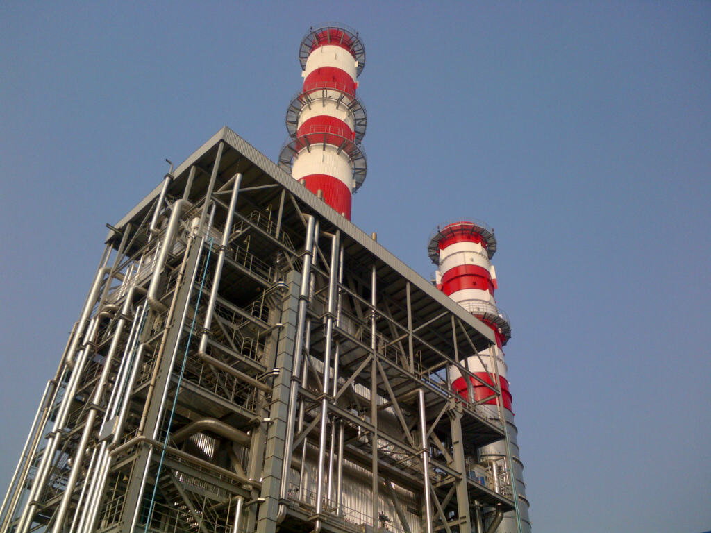 Power station with red and white towers on top