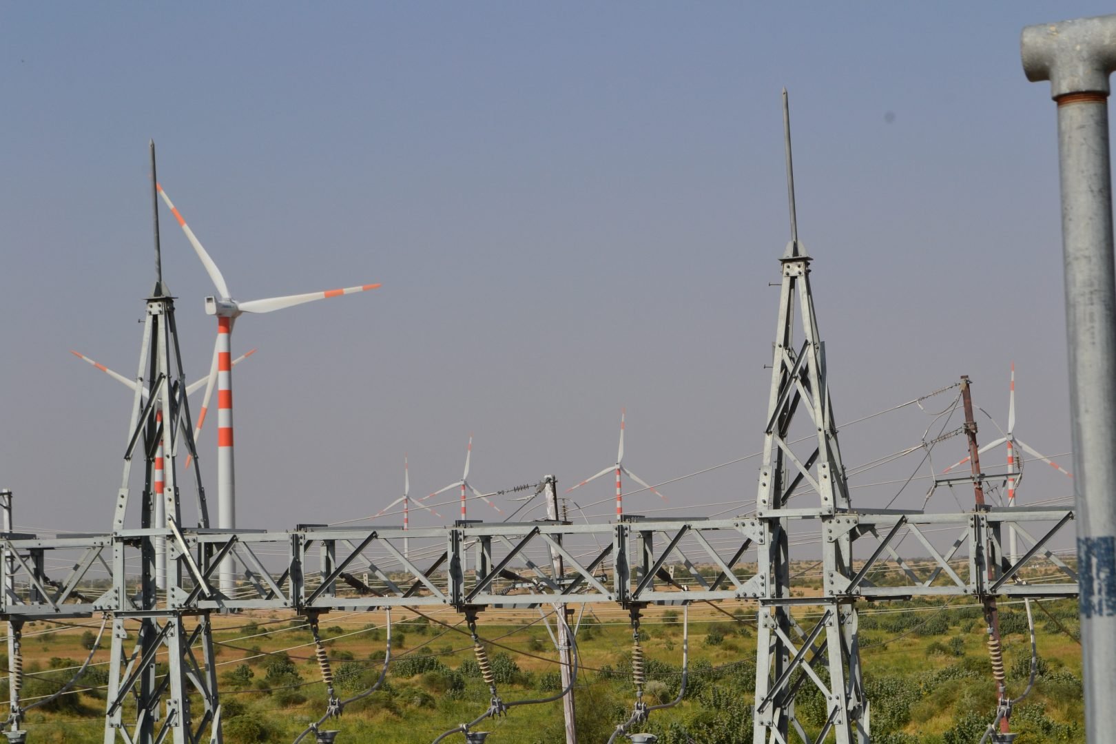 Wind turbine surrounded by power pylons