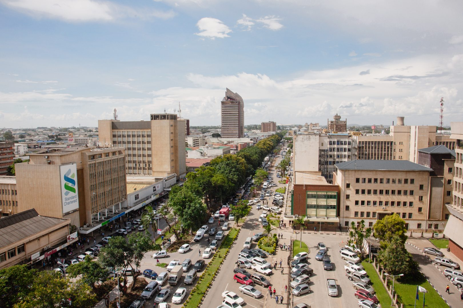 An aerial picture of traffic on a busy street in downtown Lusaka.