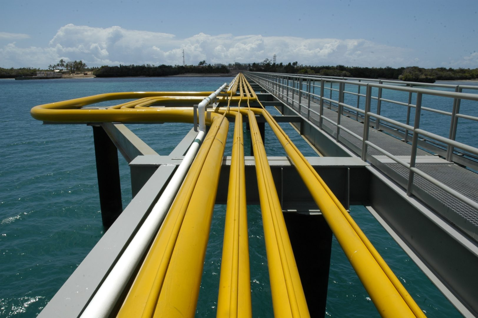Yellow pipes extending out across some water