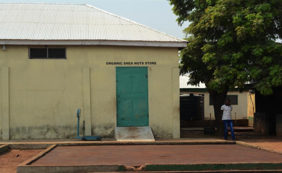 A Ghanaian hut with a green door