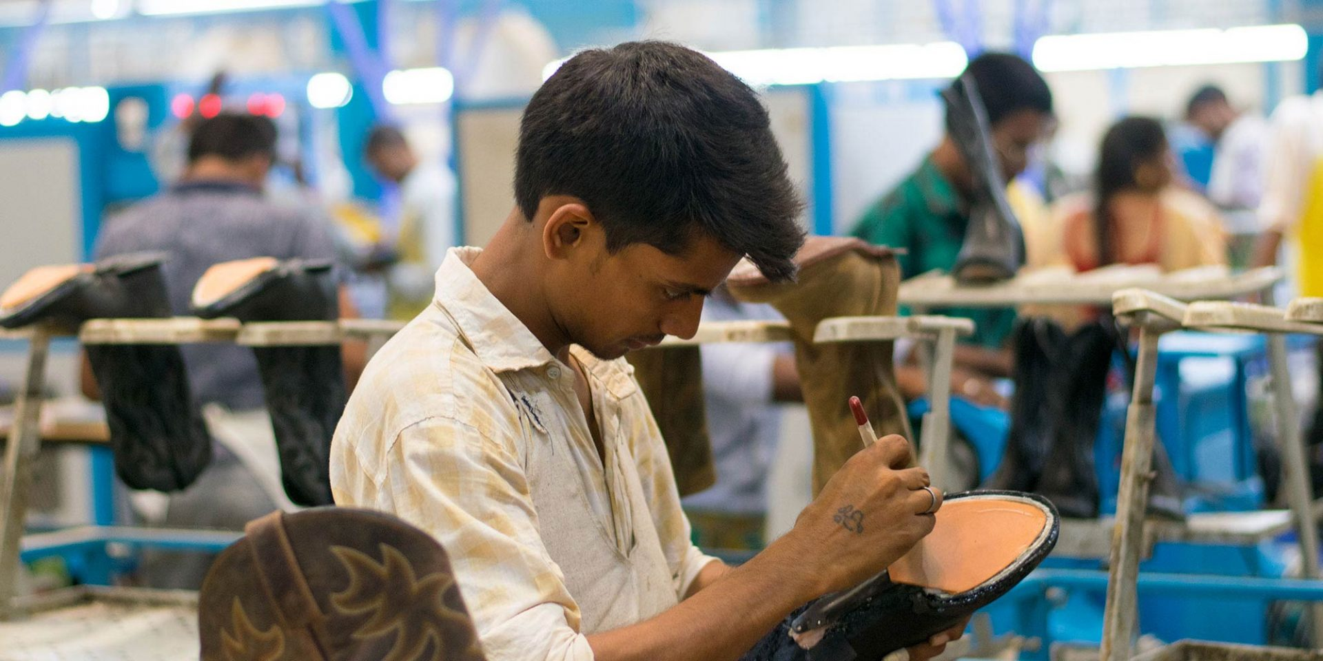 A man works on creating a shoe