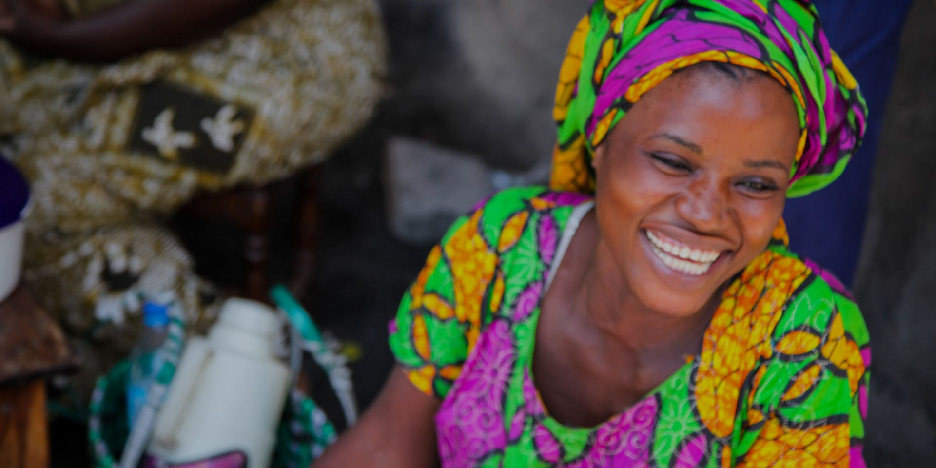 Brightly dressed women shows her smile