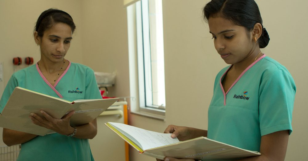 Two female Indian doctors comparing notes