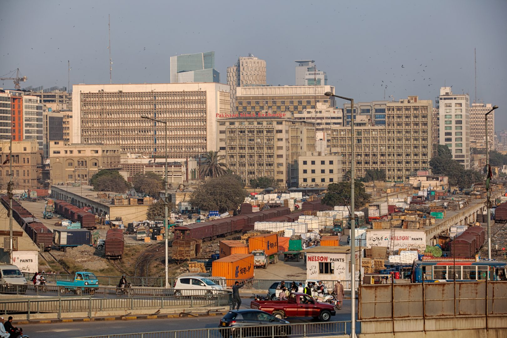 An elevated view shows the business and financial hub of Karachi, Pakistan