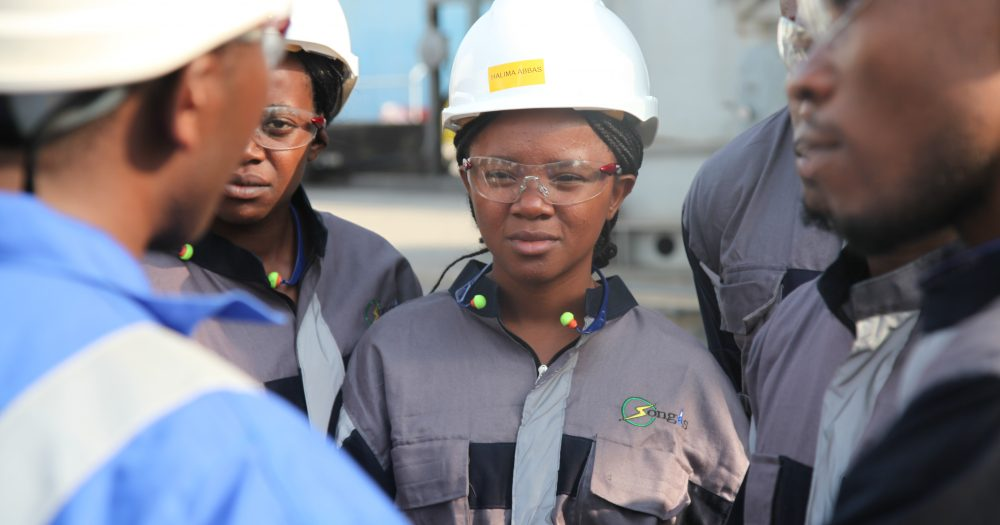 Young female worker part of a gender diverse team